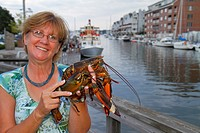 Maine, Portland, Historic Old Port District, Long Wharf, Lucky Catch Cruises, lobstering excursion, woman, holding, lobster