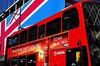 Oxford Street view during the London 2012 Olympics with the Union Flag draped John Lewis department store and a red London double-decker bus