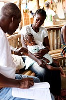 Child suffering from malnutrition in medical consultation with a doctor in a Therapeutic Feeding Center in Monrovia, Liberia, implemented by Action co...