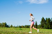 Jogging young sportive woman meadows sunny day