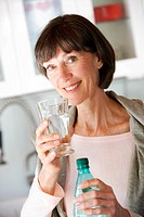 Woman drinking mineral water.