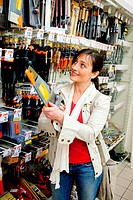 Woman shopping in a do_it_yourself section in supermarket.