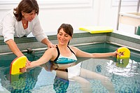 Rehabilitation session in an aquatic environment with a physiotherapist. Department of Physical Medicine and Rehabilitation, Limoges hospital, France.