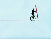 Man on unicycle drawing line