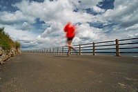 Runner on paved coastal road