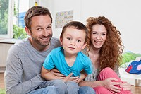 Germany, Berlin, Portrait of family at home, smiling (thumbnail)