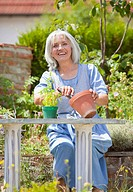 Germany, Bavaria, Mature woman gardening, smiling