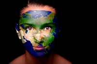 Girl with a painted map of Asia on his face.