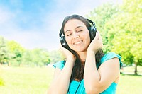 Happy beauty young woman with headphones