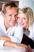 Germany, Mid adult couple smiling, close_up