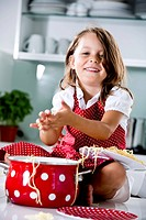 Germany, Girl playing with spaghetti, smiling, portrait