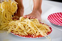 Germany, Girl standing in spaghetti (thumbnail)