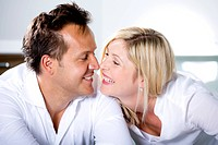Germany, Mid adult couple touching nose, smiling