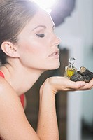 Germany, Young woman holding truffles and truffle oil