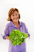 Senior woman with salad, smiling, portrait