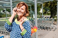 Germany, Munich, Senior woman talking on smart phone
