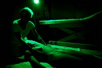 Reportage in the Chrysalide wellness centre in France that specialises in chromotherapy. A patient is massaged by Dr Bourdin while receiving chromothe...