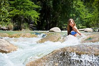 USA, Texas, Young woman enjoying in Frio river