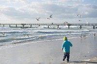 Germany, Mecklenburg Western Pomerania, Boy running on Baltic Sea