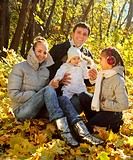 Family with two daughters in autumn forest