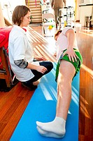 Teenager physical therapy session with a physiotherapist.