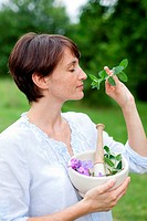 Woman picking plants come prepared to make an aromatic.