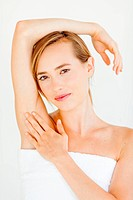 Woman touching her underarm.