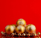 golden christmas balls of red background
