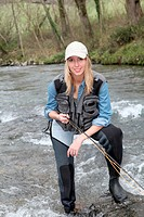 Woman fly_fishing in river