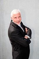 Portrait of senior businessman standing outdoors