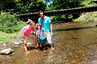 Family fishing in river