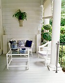 Seating arrangement is made in the porch on a bright day