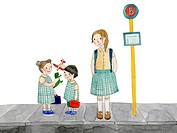 Kids in uniform waiting at a bus stop