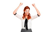 Portrait of an attractive young businesswoman raising her arms in delight