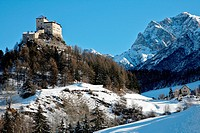 Tarasp Switzerland mountains in the winter and a castle