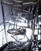 Glassware Stacked in Large Glass Vase