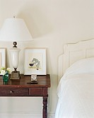 View of Nightstand by White Bed