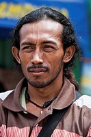 Indonesia, Papua New Guinea, Jayapura. Close_up shot of man.
