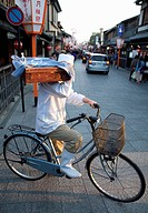 Noodle delivery by bicycle in Gion district, Kyoto