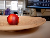 Nectarine on a wooden plate in an office