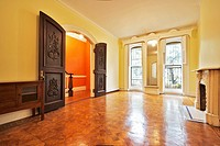 Empty Room With Hardwood Parquet Floor and Large Doorway