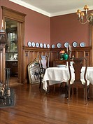 Traditional style dining room with dark wood paneling