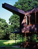 Prominent patinated copper girder in multi_story home