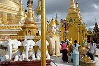 The Shwedagon Pagoda officially titled Shwedagon Zedi Daw also known as the Great Dagon Pagoda and the Golden Pagoda, is a 99 metres  325 ft  gilded p...