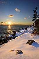 Sunrise over the Atlantic Ocean in winter as seen from near Schooner Head on Maine´s Acadia National Park.