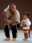 USA, North Carolina, Cherokee. Cherokee man, member of the Warriors of AniKituhwa group and his son, taking part in the annual Southeast Tribes Festiv...