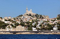 Marseille Corniche Road and Basilica of Notre-Dame-de-la-Garde from the Sea Marseille or Marseilles France