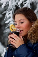 Girl drinks mulled wine