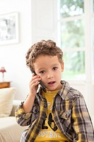 Four year old boy with cell phone