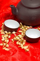 jasmine tea over red silk